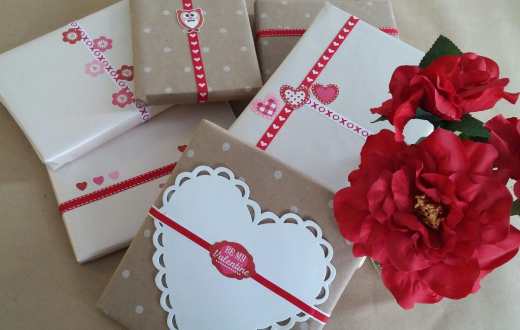 Books wrapped in brown paper with Valentine's decorations