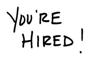 Handwritten note saying you're hired
