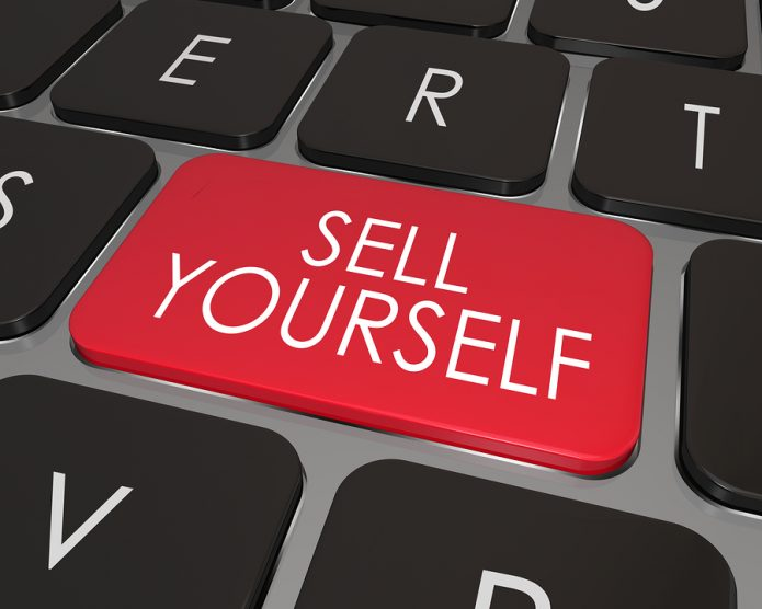 Computer keyboard button saying sell yourself