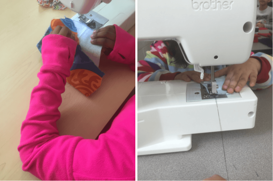 Students working on sewing machine projects