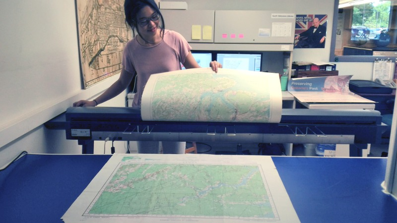 Student at McMaster University Scanning Maps
