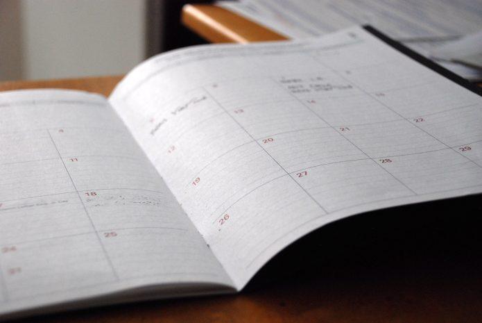 An open desk diary