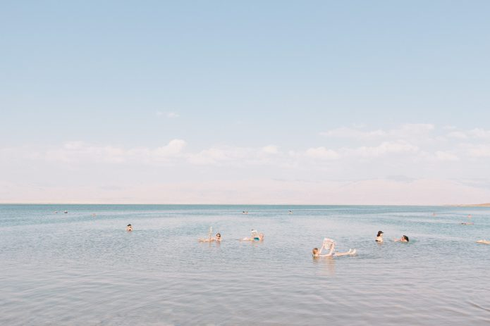 people reading in the dead sea