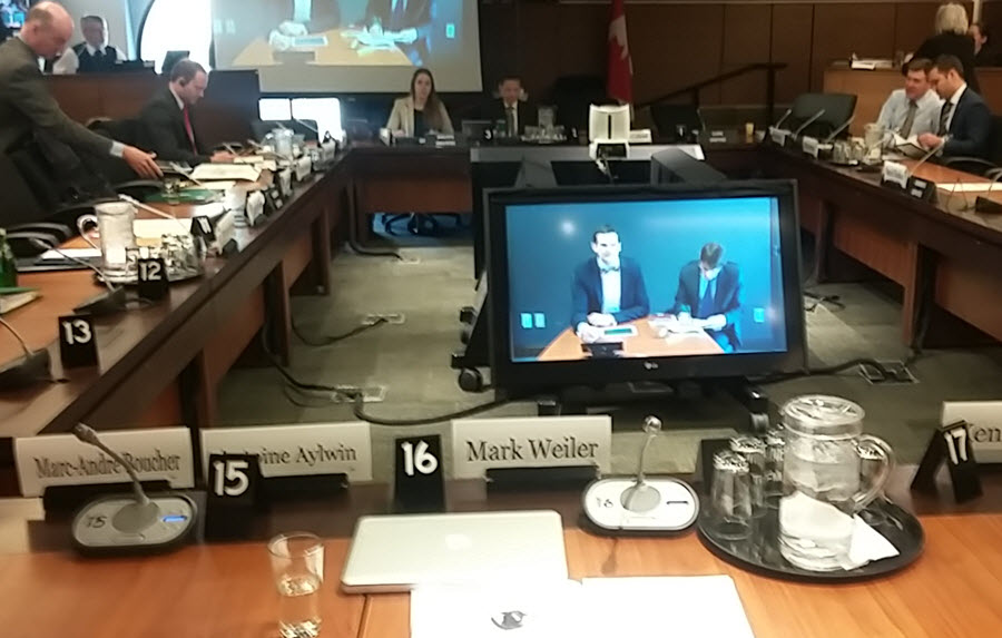 Table with name cards for the House of Commons Standing Committee on Access to Information, Privacy, and Ethics