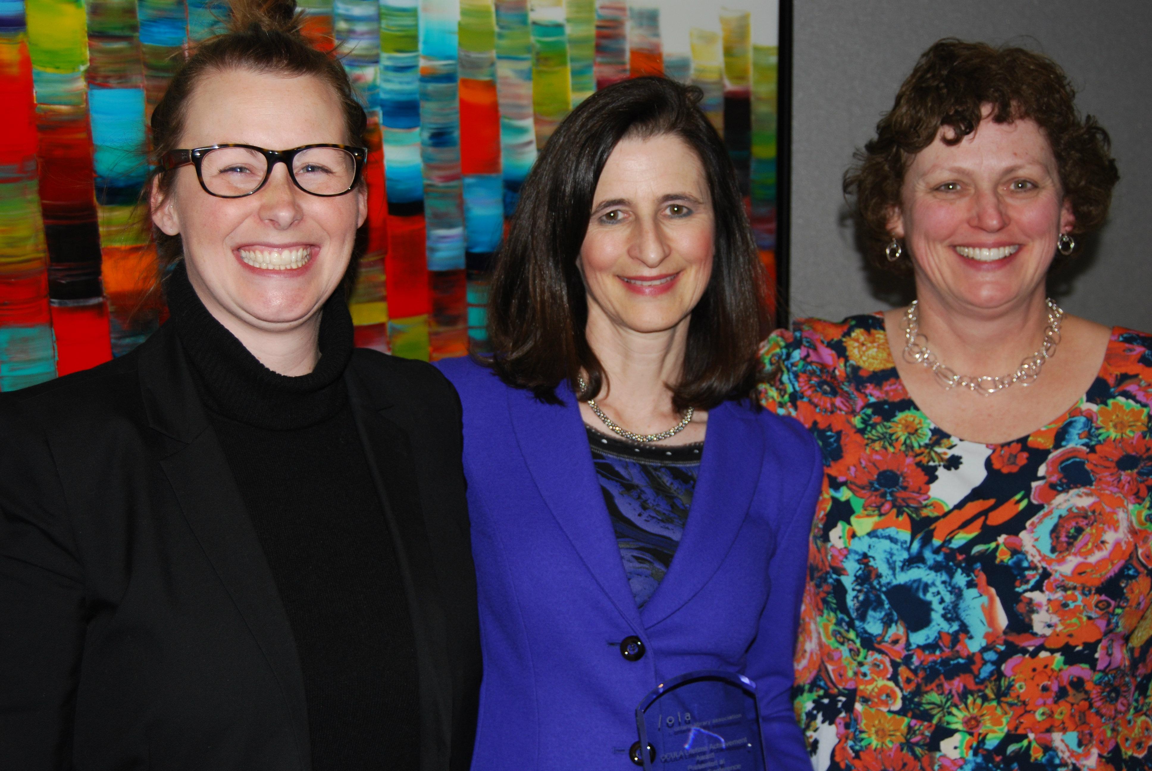 Mary Ann Mavrinac (centre), OCULA's 2014 Lifetime Achievement Award winner, along with nominators Kim Stymest (left) and Lorna E. Rourke (right) at the 2014 OCULA AGM.