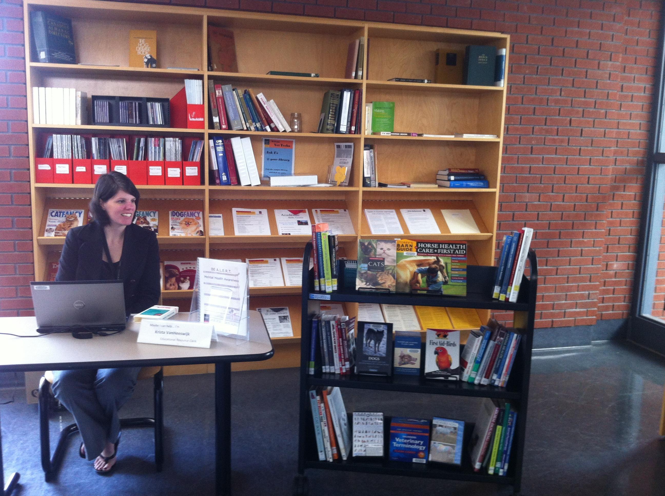 Krista van Heeswijk staffing the Pop-Up Library at Ridgetown Campus, UG